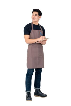 Photo pour Handsome Asian man wearing apron as a barista standing in white background - image libre de droit