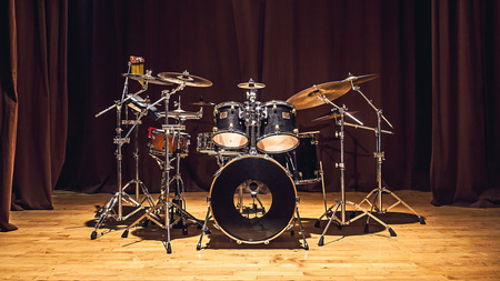 Photo for Modern drum set on stage prepared for playing. - Royalty Free Image