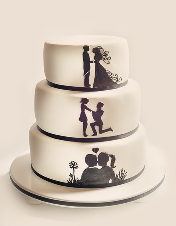 Photo for Details of a wedding cake, white sugar cream and black silhouettes. - Royalty Free Image