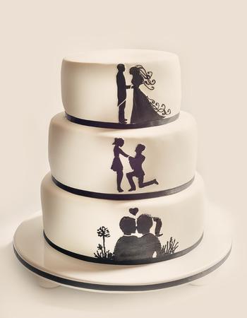 Photo pour Details of a wedding cake, white sugar cream and black silhouettes. - image libre de droit
