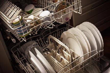 Foto de Clean dishes and accessories in dishwasher after washing. - Imagen libre de derechos