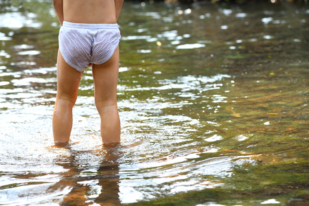 Photo pour Back view of boy with white underpants. - image libre de droit
