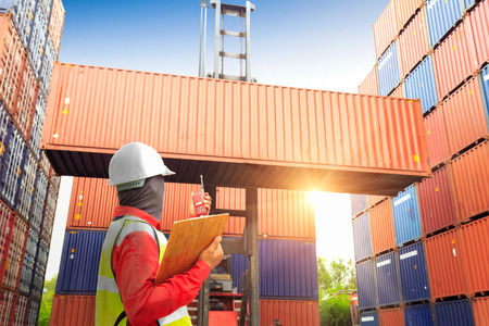 Photo for Foreman control loading Containers box to truck for Logistic Import Export Background, Business logistic concept - Royalty Free Image