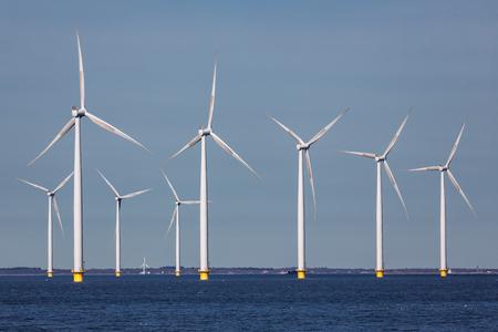 Foto de Offshore farm windturbines near Dutch coast against blue sky - Imagen libre de derechos