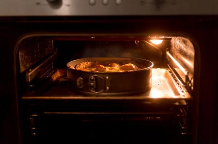 Photo pour Closeup photo of big apple pie baking in hot oven - image libre de droit