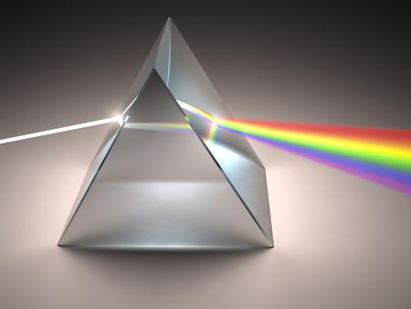 Foto de The crystal prism disperses white light into many colors. - Imagen libre de derechos