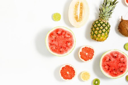 Photo pour Creative layout made of watermelon, coconut, melon, grapefruit, lime and lemon on a white background with border. Flat lay. Summer background - image libre de droit