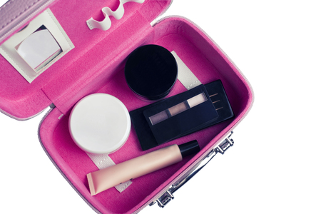 Foto de Set of womans cosmetics in a bag. Womens secrets. Cosmetics, perfume, brushes, powder, highlighter, concealer,patelle with eye shadows. female cosmetics bag on white background. Make up. Copy space - Imagen libre de derechos