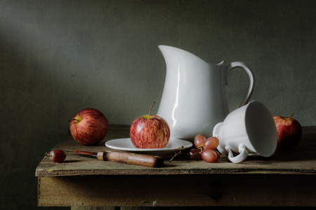 Still life with fruits and tableware