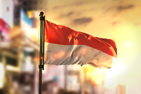 Foto de Indonesia Flag Against City Blurred Background At Sunrise Backlight - Imagen libre de derechos