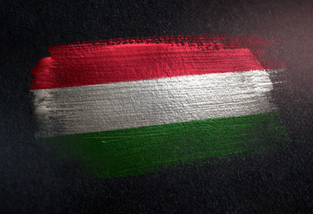 Photo pour Hungary Flag Made of Metallic Brush Paint on Grunge Dark Wall - image libre de droit