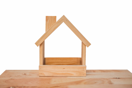 Foto für Wooden Toy House Made From Many Pieces Isolated On White Background - Lizenzfreies Bild