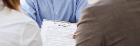 Photo pour Businessman in blue shirt offer contract form on clipboard - image libre de droit