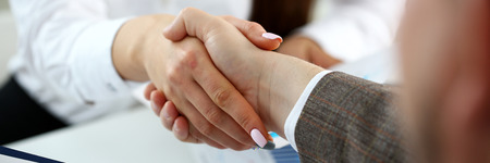 Photo for Man in suit and tie give hand as hello in office closeup. Friend welcome mediation offer positive introduction thanks gesture summit participate executive approval motivation male arm strike bargain - Royalty Free Image