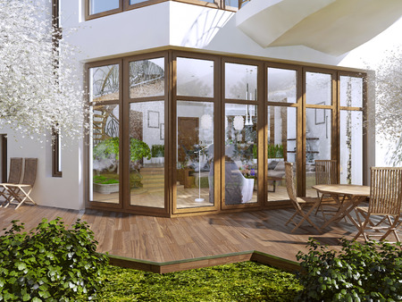 Foto de The sun terrace of a private house. Boardwalk terrace with table and chairs. Large panoramic windows overlooking the garden with a terrace. 3D render. - Imagen libre de derechos