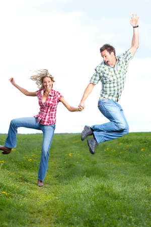 Young love couple smiling and jumping