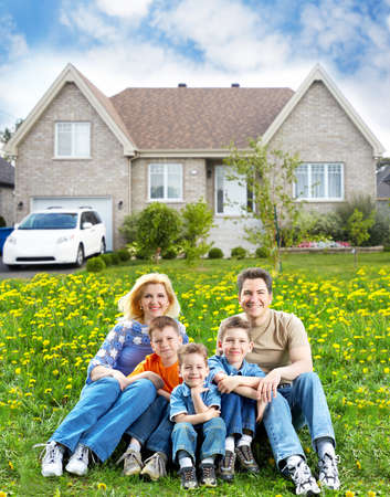 Photo for Happy family near new house  - Royalty Free Image