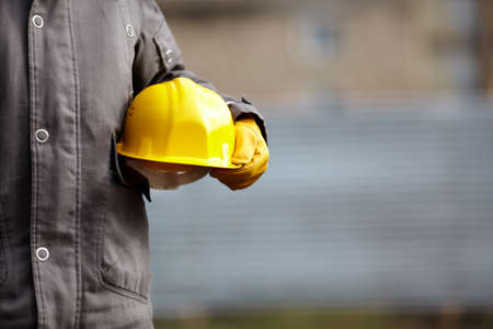 Photo for hand of builder with yellow hardhat - Royalty Free Image
