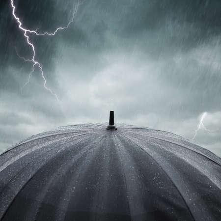 black wet umbrella , selective focus on center of photo