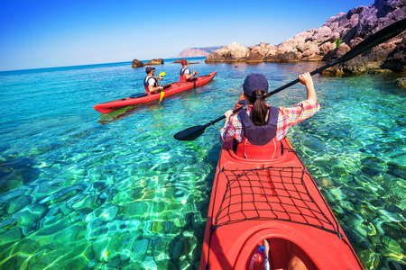 Photo pour Kayaking. The woman floating on the sea kayak. Leisure activities on the sea. Canoeing. - image libre de droit