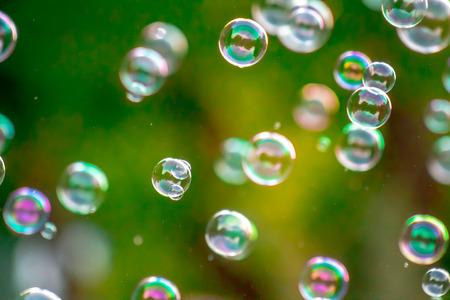 Foto de Soap bubbles in nature as a background blur - Imagen libre de derechos