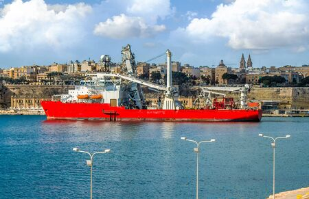 Photo for Large cargo ship for underwater work in the port of Malta - Royalty Free Image