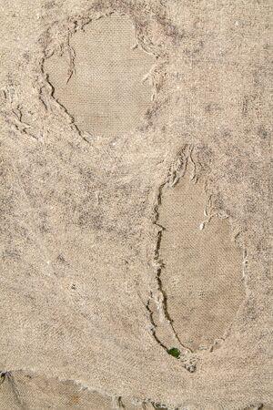 Foto de Old ragged floor cloth as an abstract background - Imagen libre de derechos