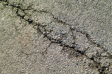 Photo for asphalt cracks close-up as a background - Royalty Free Image