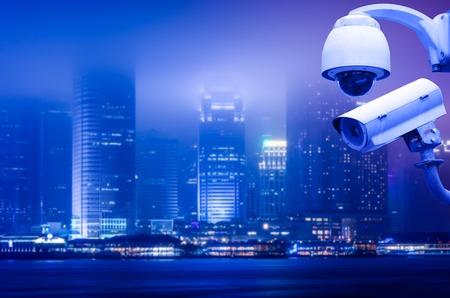 Foto de Surveillance Security Camera or CCTV over city - Imagen libre de derechos