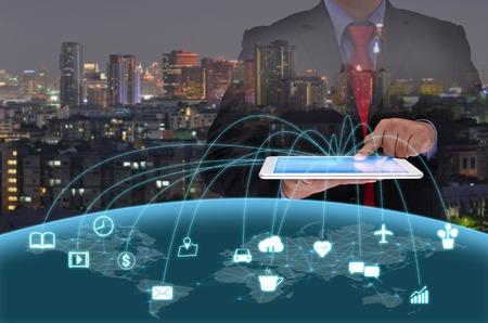 Photo pour businessman in black suite using tablet control the world , internet of things concept - image libre de droit
