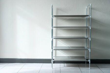 Foto de empty five layer shoes rack holder - Imagen libre de derechos