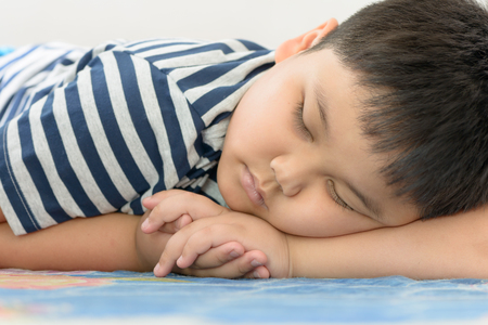Photo for fat boy sweet dream on his arm - Royalty Free Image