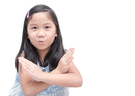 Photo for cute asian girl making stop gesture over white background, sign and symbol concept. - Royalty Free Image