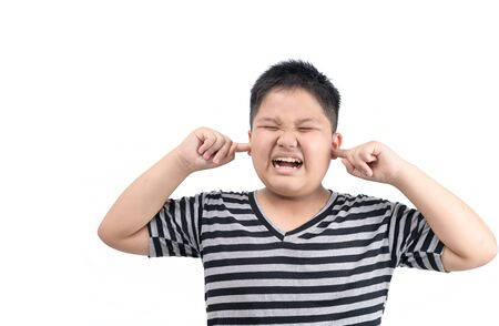 Foto de Obese fat boy covering ears ignoring annoying loud noise isolated on white background, plugs ears to avoid hearing sound. - Imagen libre de derechos