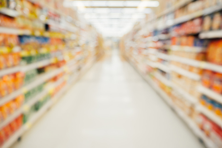 Photo for Supermarket aisle with product shelves abstract blur defocused background - Royalty Free Image