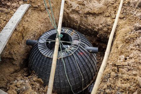 Photo pour septic tank installation into the ground - image libre de droit