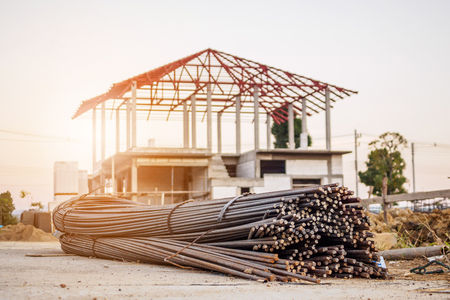 Photo for steel rebar for reinforcement concrete at construction site with house under construction background - Royalty Free Image