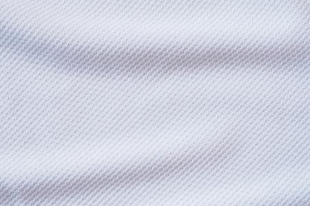 Foto de White football jersey clothing fabric texture sports wear background, close up - Imagen libre de derechos
