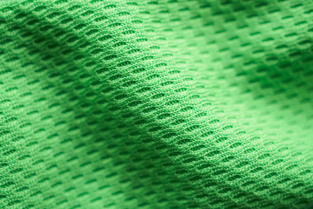 Photo pour Green fabric sport clothing football jersey with air mesh texture background - image libre de droit