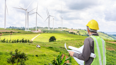 Photo for Engineer worker at wind turbine power station construction site - Royalty Free Image
