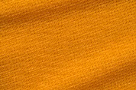Photo pour Orange color sports clothing fabric jersey football shirt texture top view - image libre de droit