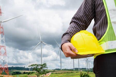Foto de Engineer worker at wind turbine power station construction site - Imagen libre de derechos