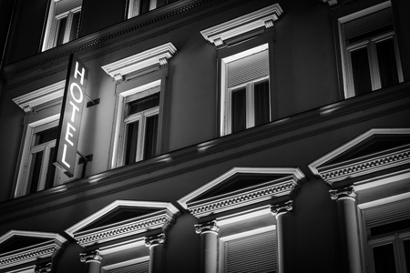 Photo for Glowing hotel sign in night on old building. Architecture of Budapest, Hungary, Europe, travel. - Royalty Free Image