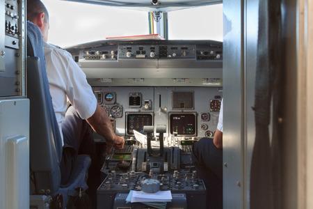 Photo pour A view into a an airplane cockpit with pilots after landing - image libre de droit