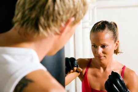 Boxing couple (male / female), trainer supervising the boxing student
