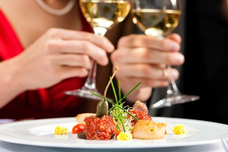 Photo for Couple for romantic Dinner or lunch in a gourmet restaurant - Royalty Free Image