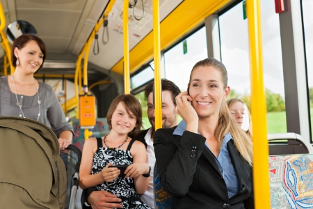 Passengers in a bus - a commuter, a woman with a stroller, a man