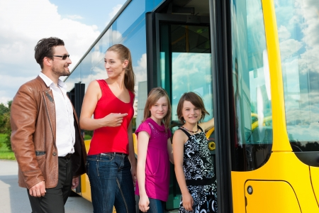 Passengers boarding a bus at a bus station
