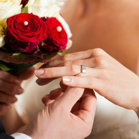 Wedding couple with bouquet and bridal ring