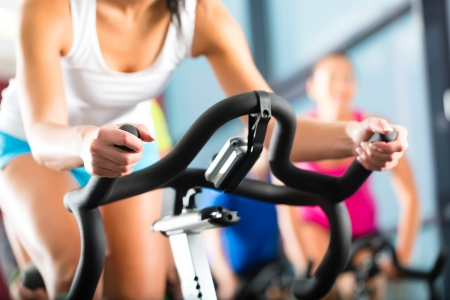 Photo for Young People - group of women and men - doing sport Spinning in the gym for fitness - Royalty Free Image